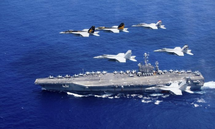 A combined formation of aircraft from Carrier Air Wing (CVW) 5 and Carrier Air Wing (CVW) 9 pass in formation above the Nimitz-class aircraft carrier USS John C. Stennis (CVN 74) in the Philippine Sea on June 18, 2016. (Steve Smith/U.S. Navy/Handout via Reuters)