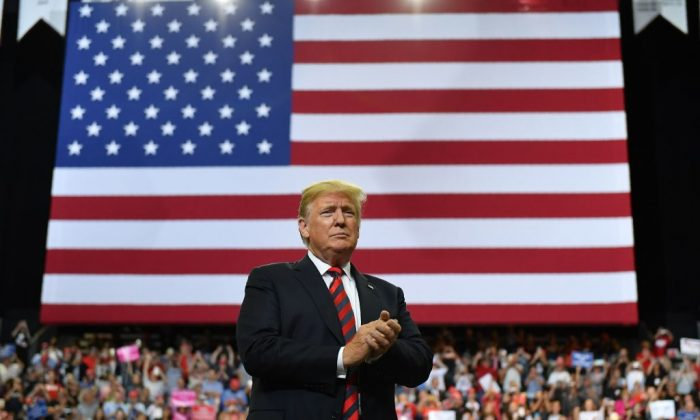 US President Donald Trump looks at the crowd during a rally at JQH Arena in Springfield, Missouri on Sept. 21, 2018. (Mandel Ngan/AFP/Getty Images)