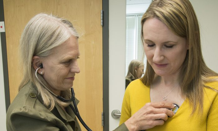 When emergency tests showed the telltale right-sided pain in VanDusen's abdomen was appendicitis, she figured she'd be quickly wheeled into surgery. But doctors offered her the option of antibiotics instead. (Clare McLean/UW Medicine via AP)