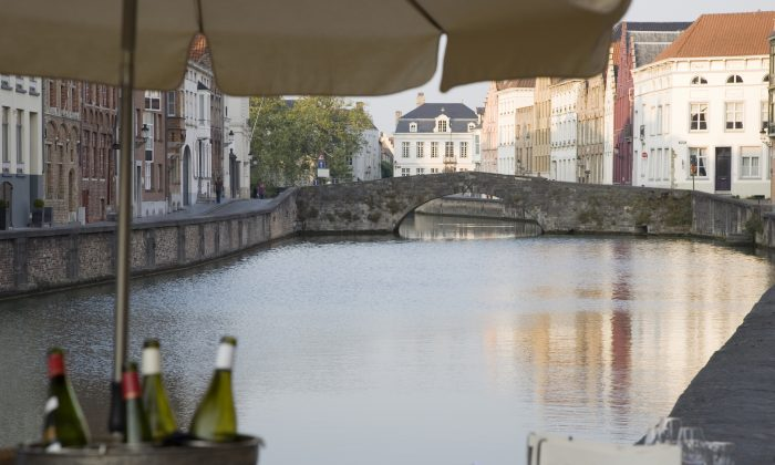 Wine bottles by the canals of Bruges in Belgium in this file photo. Belgium's wine industry is booming, with vineyard owners predicting 2018 to be their best year. (Kevin George/Shutterstock)