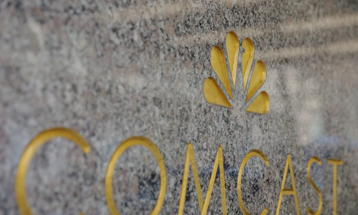 The NBC and Comcast logos are displayed on 30 Rockefeller Plaza in midtown Manhattan in N.Y., Feb. 27, 2018. (Lucas Jackson/Reuters)