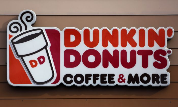 The company is renaming itself Dunkin' to reflect its increasing emphasis on coffee and other drinks. The change will officially take place in January 2019. (Gene J. Puskar, File/AP)