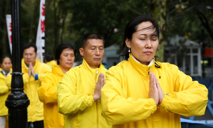Falun Gong practitioners protest the persecution of the spiritual practice at the United Nations in New York, on Sept. 25, 2018. (Samira Bouaou/The Epoch Times)