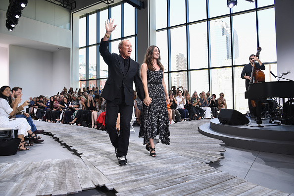 Designer Michael Kors and singer Sara Bareilles walk the runway at the Michael Kors Collection Spring 2018 Runway Show at Spring Studios in New York City on Sept. 13, 2017. (Dimitrios Kambouris/Getty Images for Michael Kors)