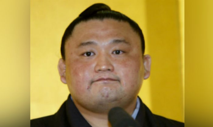 Sumo grand champion Takanohana speaks during a news conference at Kokugikan national sumo stadium in Tokyo Jan. 20, 2003. (Toshiyuki Aizawa/Reuters)