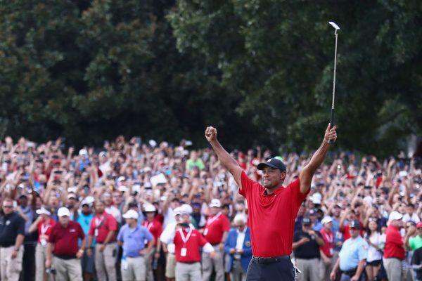 Tiger Woods celebrates victory