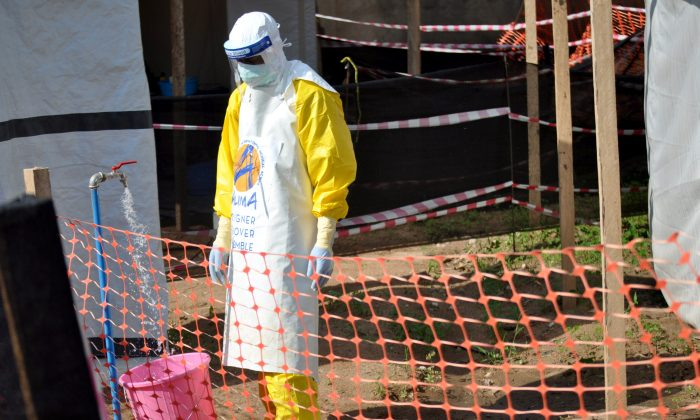 A medical worker wears a protective suit as he prepares to administer Ebola patient care at the Alliance for International Medical Action  treatment center in Beni,  Democratic Republic of Congo on Sept. 6, 2018. (Reuters/Fiston Mahamba)