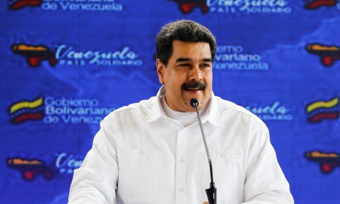 Venezuela's President Nicolas Maduro speaks during an event with foreign migrants living in Venezuela, in Caracas, Venezuela Sept. 25, 2018. (Miraflores Palace/Handout via Reuters)