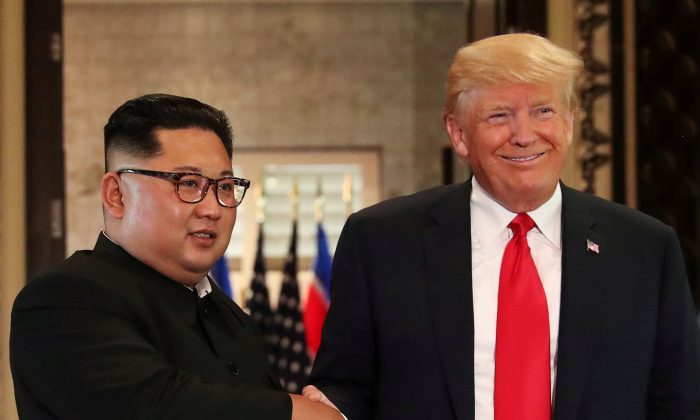 President Donald Trump and North Korea's leader Kim Jong Un during a summit at the Capella Hotel on the resort island of Sentosa, Singapore, June 12, 2018. (Reuters/Jonathan Ernst/File Photo)