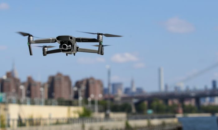 A new DJI Mavic Zoom drone flies during a product launch event at the Brooklyn Navy Yard, August 23, 2018 in New York City. (Drew Angerer/Getty Images)