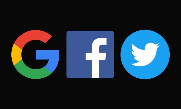 The logos of Google, Facebook, and Twitter are seen in a file photo.