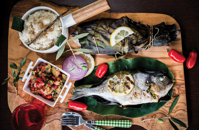 Inihaw na isda, stuffed fish wrapped in banana leaves and grilled atop burning charcoal, demonstrates a distinctive cooking method of Filipino cuisine. (Rowena Dumlao-Giardina)