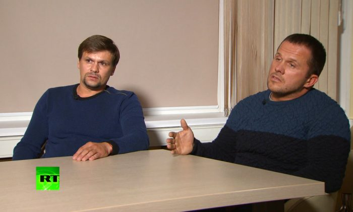 Ruslan Boshirov, left, and Alexander Petrov attend their first public appearance in an interview with the RT channel in Moscow, Russia. In this video grab provided by the RT channel on Sept. 13, 2018. (RT channel video via AP)