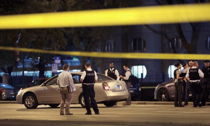 Police investigate the scene of a shooting near the Chinatown neighborhood where four people were shot in an apparent road rage incident on Sept. 19, 2018, in Chicago, Ill. A 6-month-old infant boy and a 13-year-old girl were among the victims.  (Scott Olson/Getty Images)