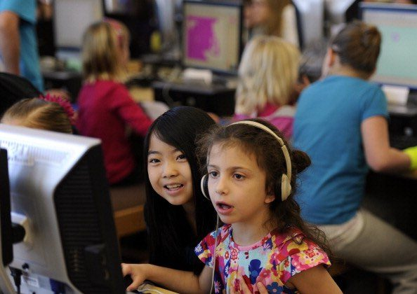 Salinas kindergarteners and their families have a chance to get to know their public library system. (Joe Amon/Getty Images)