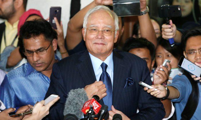 Malaysia's former Prime Minister Najib Razak leaves a court in Kuala Lumpur, Malaysia on Sept. 20, 2018. (Reuters/Lai Seng Sin)