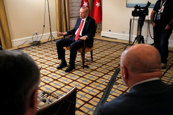 Turkish President Tayyip Erdogan sits during an interview