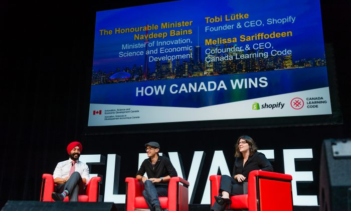 Innovation Minister Navdeep Bains, Shopify's founder and CEO Tobi Lütke, and, Cofounder and CEO of Canada Learning Code Melissa Sariffodeen open Elevate, Canada's innovation and tech festival at Sony Centre in Toronto on Sept. 25. (Photagonist.ca)