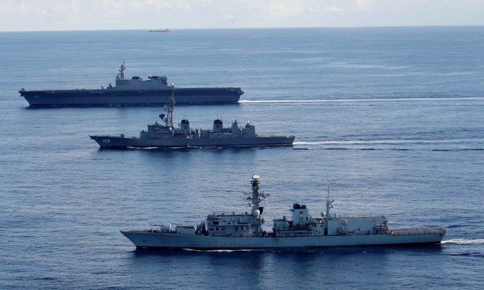 British frigate HMS Argyll (front), Japanese destroyer Inazuma (C) and Japanese helicopter carrier Kaga take part in a joint naval drill in the Indian Ocean on Sept. 26, 2018. (Kim Kyung-Hoon/Reuters)