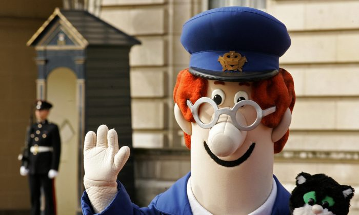 An actor dressed in the costume of animated children's television character Postman Pat leaves Buckingham Palace in London, 23 May 2006. (Carl De Souza/AFP/Getty Images)
