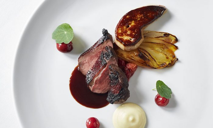 Grilled breast of young pigeon with seared foie gras, sour cherries from the orchard, and caramelized endive at the Inn at Little Washington. (Greg Powers)