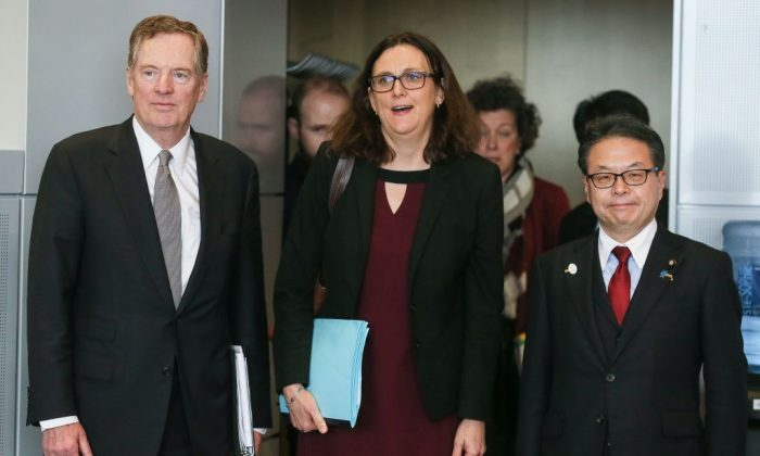 European Commissioner for Trade Cecilia Malmstrom (C), US trade representative Robert Lighthizer (L) and Japan's Economy Minister Hiroshige Seko arrive for a meeting for talks at the European Commission headquarters in Brussels, on March 10, 2018. (STEPHANIE LECOCQ/AFP/Getty Images)