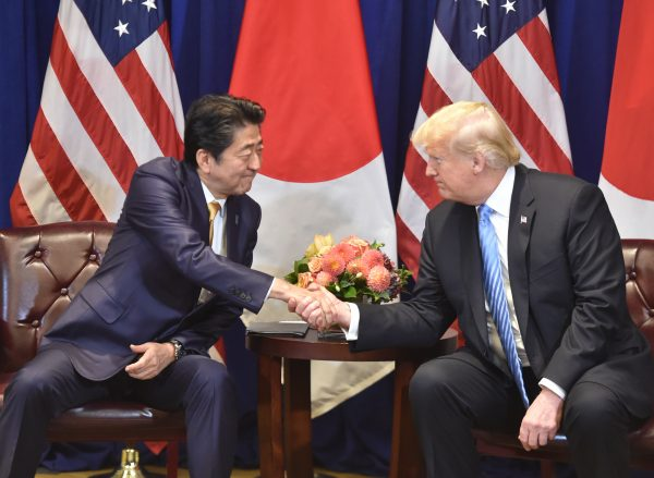 Japanese Prime Minister Shinzo Abe (L) meets with US President Donald Trump