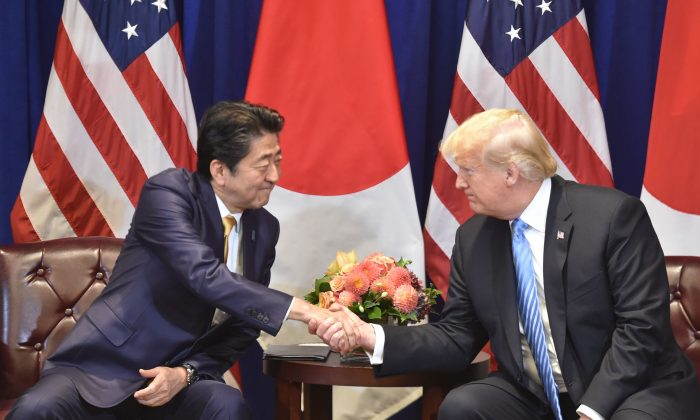 Japanese Prime Minister Shinzo Abe (L) meets with US President Donald Trump, on the sidelines of the United Nations General Assembly (UNGA) in New York on Sept. 26, 2018. (NICHOLAS KAMM/AFP/Getty Images)
