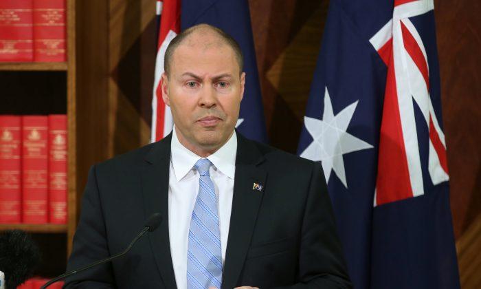 Australian Treasurer Josh Frydenberg speaks to the media during a press conference in Melbourne, Australia, Sept. 28, 2018.  (AAP/David Crosling/via Reuters)