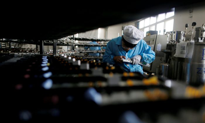 A laborer works inside an electronics factory in Qingdao, Shandong Province, China on January 29, 2018. (William Hong/Reuters)
