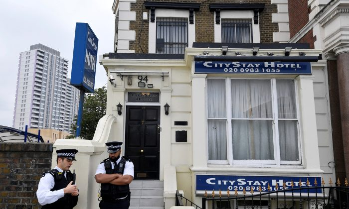 Police officers stand outside the City Stay Hotel used by Alexander Petrov and Ruslan Boshirov; who have been accused of attempting to murder former Russian spy Sergei Skripal and his daughter Yulia; London,  on Sept. 5, 2018. (Reuters)
