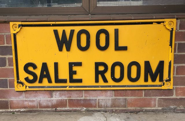A wool sale room sign is pictured outside an auction, sampling and storage and distribution centre in Yennora, Sydney, Australia Sept. 20, 2018. (Reuters/Jonathan Barrett)