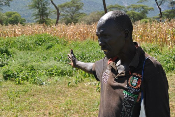 Bethuel Kibor, a member of the Marakwet tribe, points at the maize farm.