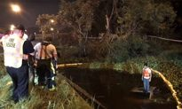 First Responders Rescue Driver From Atop Submerged Car