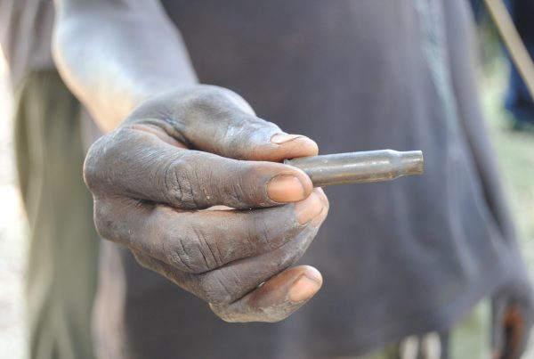 Bethuel Kibor, a member of the Marakwet tribe, holds a bullet canister in Rift Valley, Kenya.
