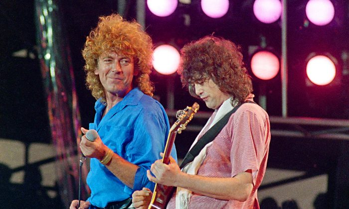 Led Zeppelin bandmates, singer Robert Plant (L), and guitarist Jimmy Page, reunite to perform for the Live Aid famine relief concert at JFK Stadium in Philadelphia, on July 13, 1985. (Amy Sancetta/AP)