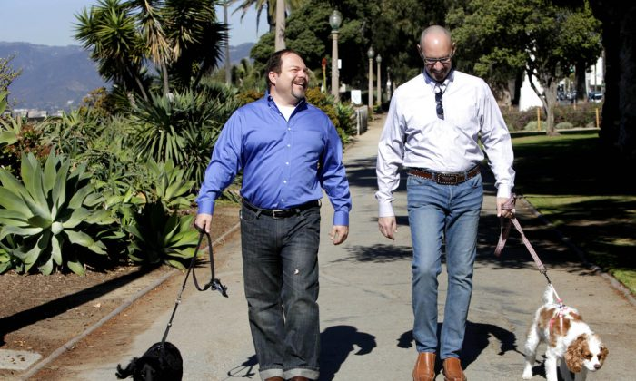 Steven May, right, walks with his dog, Winnie beside his attorney, David Pisarra, with his dog, Dudley in Santa Monica, Calif. on Feb. 23, 2012. (AP Photo/Nick Ut)