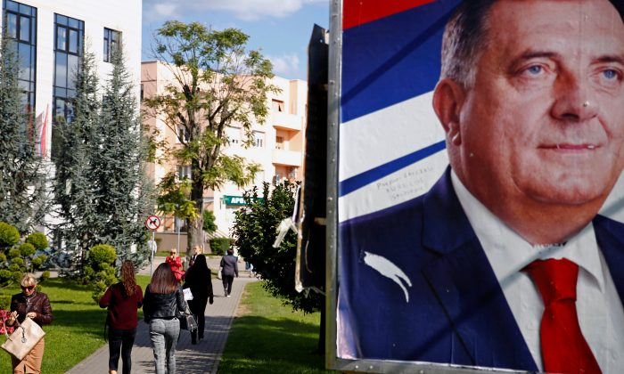 People pass by Milorad Dodik's pre-election poster in Banja Luka, Bosnia and Herzegovina, on Sept. 26, 2018. (Dado Ruvic/Reuters)