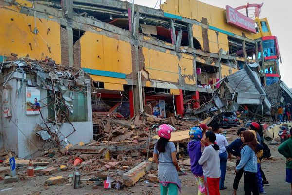 Residents front damaged shopping mall