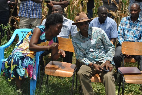 Tegla Lorupe, a humanitarian and former start Kenyan athlete, talks with Joseph Boinnet, inspector general of police.