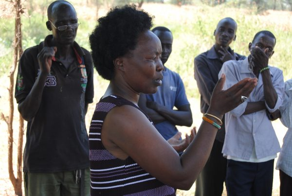Tegla Lorupe, a humanitarian and former start Kenyan athlete, talks to reformed cattle rustlers.