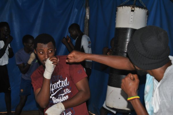 Young men practice at a boxing club established by the Tegla Lorupe Foundation in Nairobi.