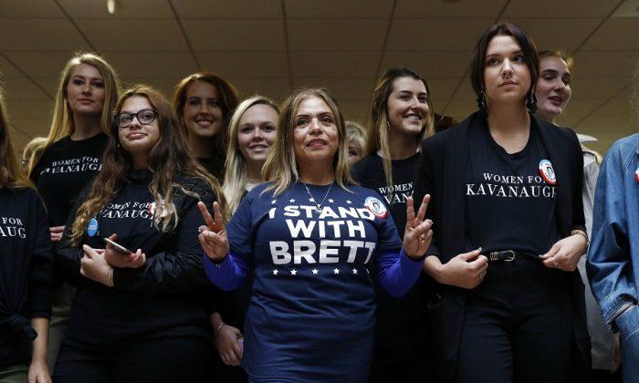 Supporters of Supreme Court nominee Brett Kavanaugh gather inside the Hart Senate Office Building on Capitol Hill in Washington, on Sept. 27, 2018. (AP Photo/Patrick Semansky)