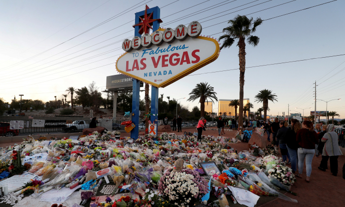"The ""Welcome to Las Vegas"" sign is surrounded by flowers and items, left after the October 1 mass shooting, in Las Vegas, Nev., on Oct. 9, 2017. (Las Vegas Sun/Steve Marcus)"