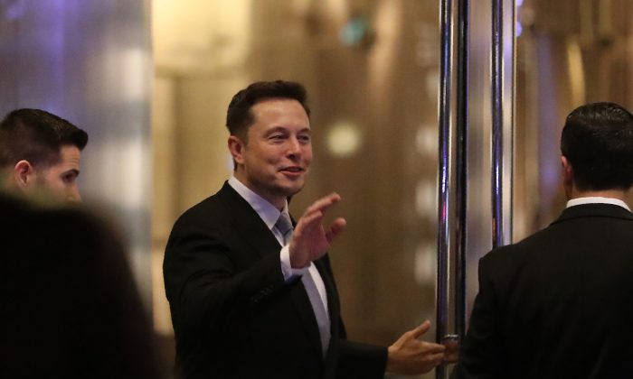 Elon Musk, the co-founder and chief executive of Electric carmaker Tesla, gestures during a ceremony in Dubai, on Feb. 13, 2017. (Karim Sahib/AFP/Getty Images)