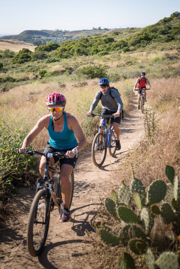 People mountain bike in Bommer Canyon Irvine