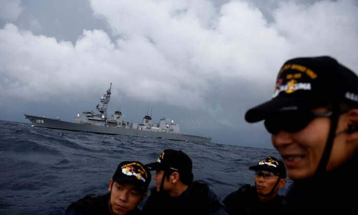 Japanese destroyer Inazuma is seen behind one of its ship inspection teams on a small patrol boat in the Indian Ocean on Sept. 27, 2018. (Kim Kyung-Hoon/Reuters)