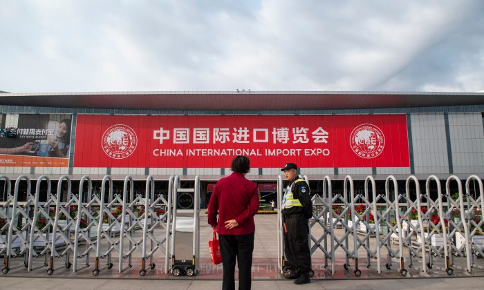 A security guard stands in front of the entrance of the National Exhibition and Convention Center (Shanghai), the main venue to hold the upcoming first China International Import Expo (CIIE), is seen in Shanghai on October 31, 2018. (JOHANNES EISELE/AFP/Getty Images)