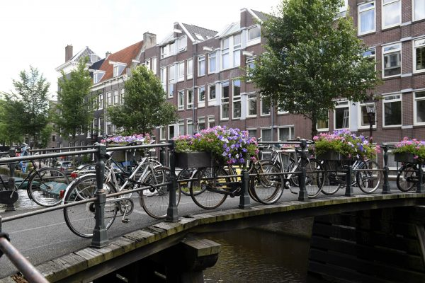Bikes parked on a bridge crossing a canal in Amsterdam in this file photo.