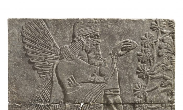 An Assyrian gypsum relief of a Winged Genius. Reign of Ashurnasirpal II, circa 883-859 B.C. 7 ft 4 in x 6 ft 5 in offered in Antiquities at Christie's in New York, on Oct. 31, 2018. (Courtesy of Christie's)